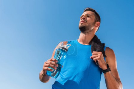 sportsman with towel and sport bottle
