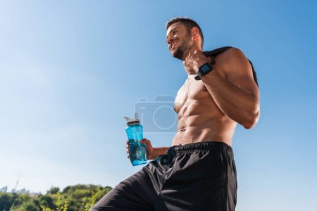 sportsman with sport bottle
