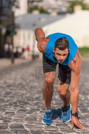 Sportsman running in city