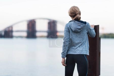 sportswoman standing on quay