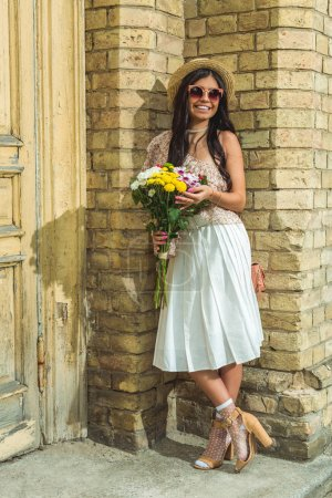 beautiful girl with bouquet of flowers