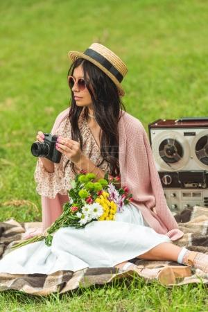 stylish girl with camera in park