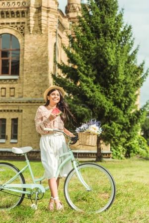 girl with watermelon and bicycle