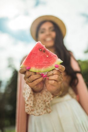 girl holding slice of watermelon