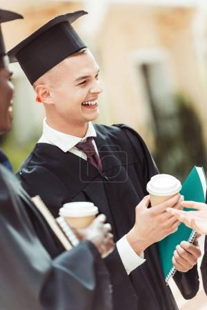 Photo for Graduated happy multiethnic students with disposable cups of coffee - Royalty Free Image