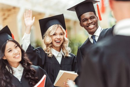 students in graduation costumes