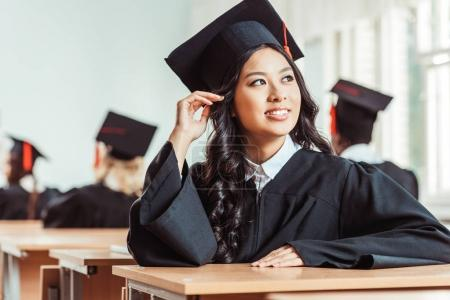 Photo for Asian student girl in graduation costume sitting at classroom - Royalty Free Image