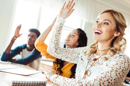 Photo for Group of multiethnic students raising hands in class on lecture - Royalty Free Image