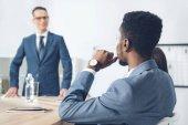 businessman listening to boss