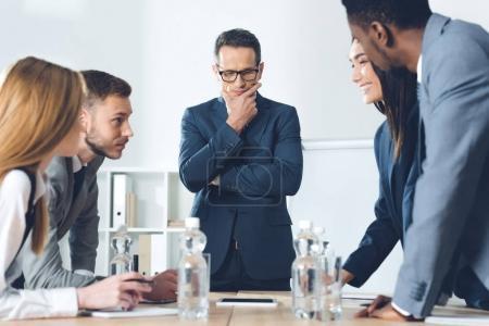 businesspeople having conversation