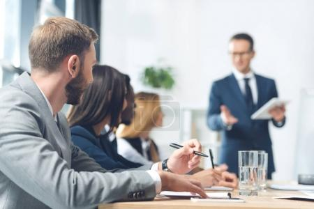 Photo for Successful young businesspeople having conversation in conference hall - Royalty Free Image