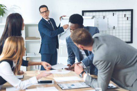 Photo for Businesspeople having conversation in conference hall - Royalty Free Image