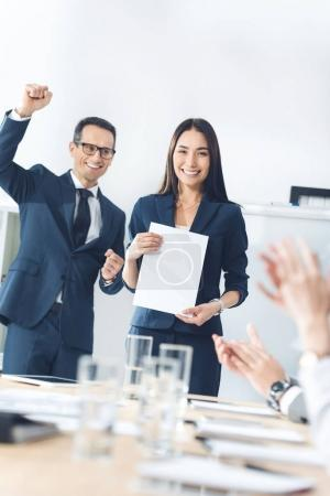 Rewarded manageress holding blank paper
