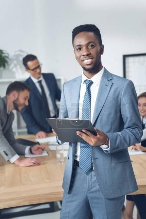 businessman with clipboard in conference hall