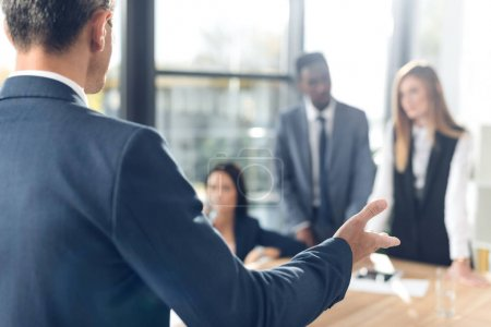Photo for Cropped shot of businessman talking to partners - Royalty Free Image