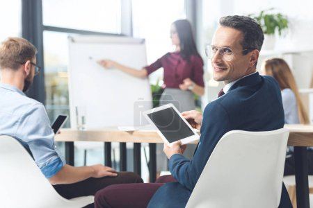 businessman with tablet at conference hall