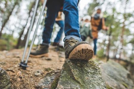 kid standing on rock