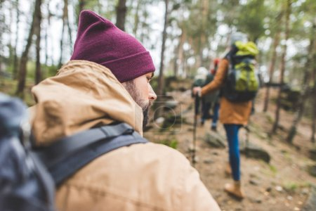 man in autumn forest