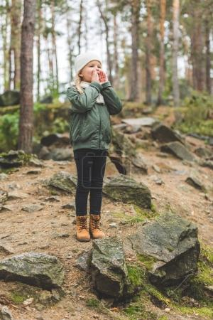 kid shouting in autumn forest