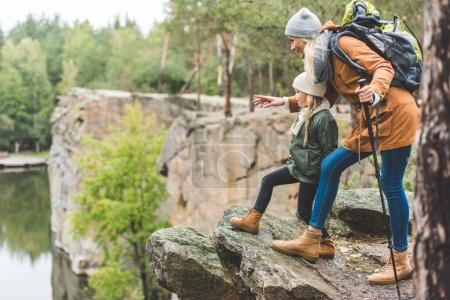 mother and daughter trekking together