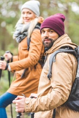 couple trekking in autumn forest