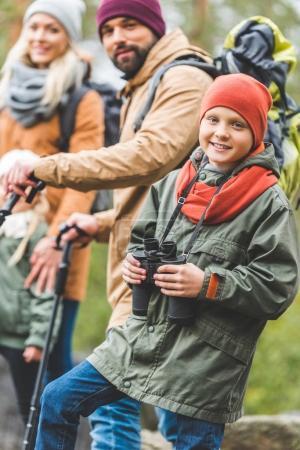 smiling boy with binoculars