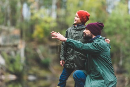 father and son in autumn forest