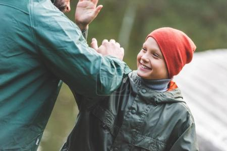 smiling family giving high five