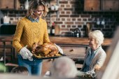 woman carrying thanksgiving turkey