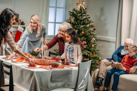 women decorating christmas table
