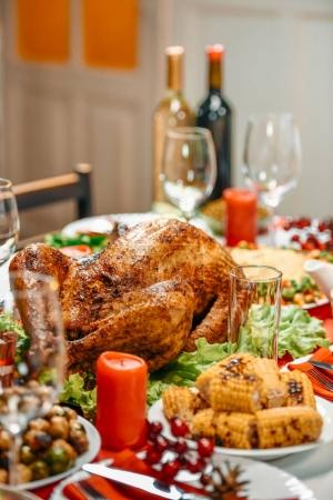 Photo for Served table with delicious dishes for christmas dinner - Royalty Free Image