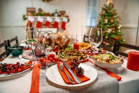 Photo for Close-up shot of served table with tasty dishes for christmas dinner - Royalty Free Image