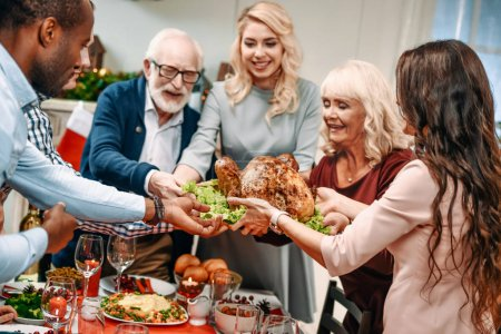 family holding christmas turkey