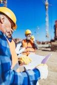 Construction worker examining building plan