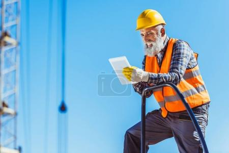 construction worker using digital tablet