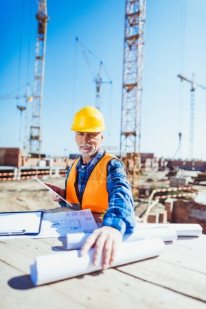 construction worker with building plans