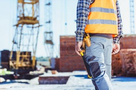 worker in reflective vest at construction site