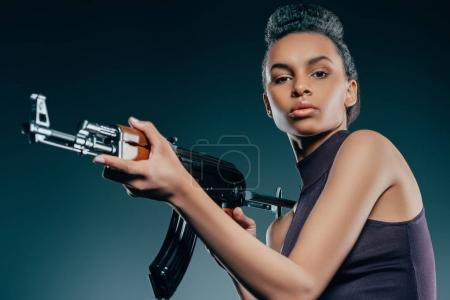 fashionable african american girl with rifle
