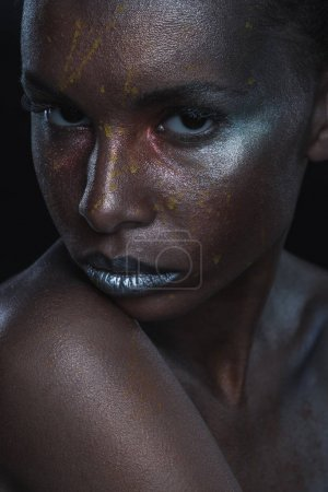 girl with silver makeup for fashion shoot