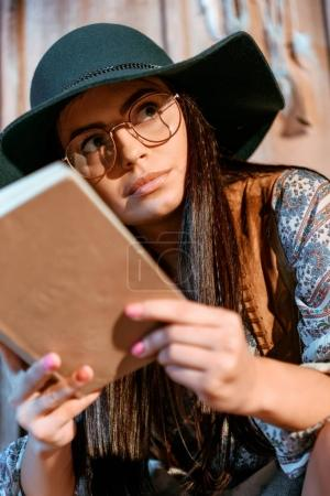 Hippie woman reading book