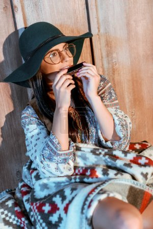 hippie girl playing harmonica
