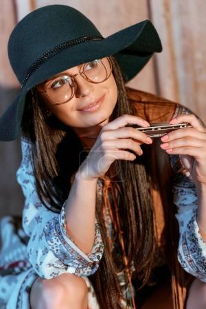 bohemian woman with harmonica
