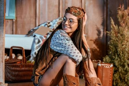 hippie girl sitting on floor