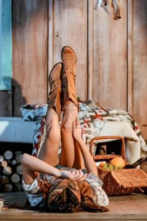 Bohemian woman lying with legs up