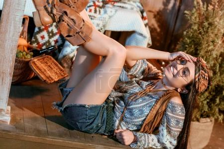 Photo for Beautiful girl in boho style smiling and lying on a floor - Royalty Free Image