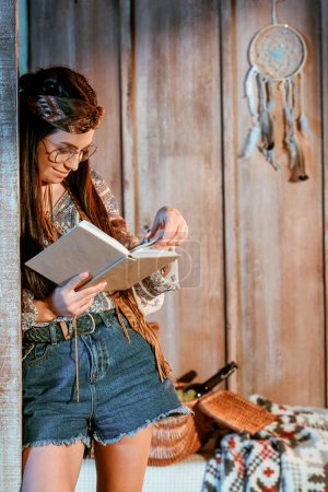 woman in boho style reading book
