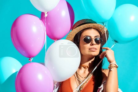 bohemian girl with helium balloons