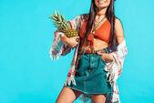 bohemian girl holding pineapple