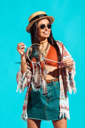 bohemian girl holding dreamcatcher