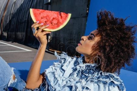 afro girl posing with slice of watermelon